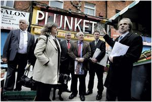 Jim Connolly-Heron (Great Grandson of James Connolly) far right, and Honor O Brolchain (Grand Neice of Joseph Plunkett) pictured on left with cream coat explain to members of the Oireachtais Environment and Heritage Committee the significance of No 16 Moore Street yesterday after paying a visit there yesterday.