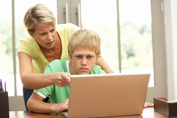 Mum helps sons study