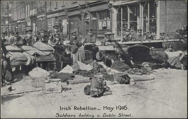 British soldiers man a barricade on a Dublin street in April 1916