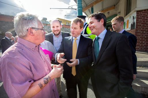 aoiseach Enda Kenny and Minister for Public Expenditure & Reform talk to Terry Fagan of North Inner City Folklore after a meeting with North Inner City residents at St Laurence O'Toole's School in Seville Place