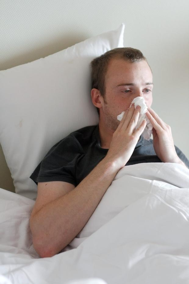 A man in bed with flu...or is it?