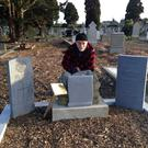 Gerry Gregg at the grave of Andrew Byrne in Deansgrange Cemetery