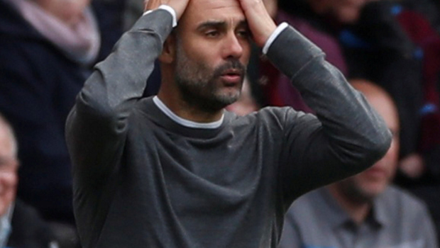 HARD GOING: Pep Guardiola reacts as his side had to tough it out at Turf Moor yesterday. Photo: Reuters