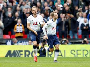 Harry Kane celebrates with teammate Christian Eriksen after levelling from the spot for Tottenham in the North London derby. Photo: REUTERS