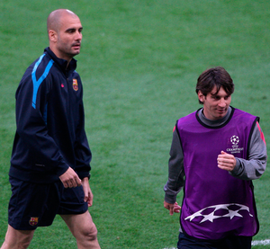 Barcelona manager Pep Guardiola (left) and Lionel Messi in 2011