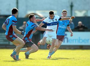 Shane Carthy, St. Vincents, in action against Shane White (7) Naomh Olaf (tackle results in a penalty).  Dublin Senior Football Championship round 1, St. Vincent's v St. Olaf, Dublin.   Picture: Caroline Quinn