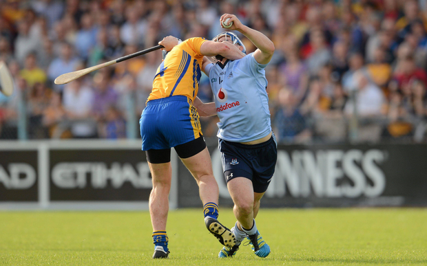 NO WAY PAST: Dublin's David Treacy is tackled by Conor Cooney of Clare during the match in 2012. Photo: SPORTSFILE