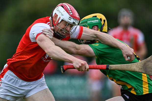 Con O'Callaghan of Cuala is tackled by Sean Kennedy of Thomas Davis
