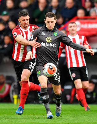 WORRY: Sheffield United's Enda Stevens (left) in action against Norwich's Kenny McLean. Pic: PA