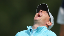 Rory McIlroy laughs after his shot from the eighth tee during a practice round for the US Open at Winged Foot. Photo: USA TODAY Sports