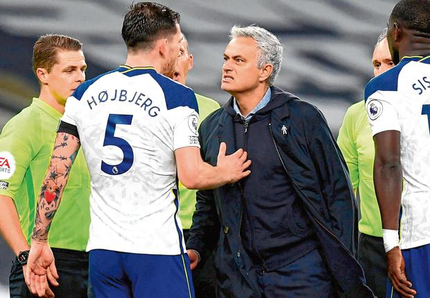 Tottenham manager Jose Mourinho speaks with Spurs midfielder Pierre-Emile Hojbjerg following their 2-0 victory against Manchester City at Tottenham Hotspur Stadium