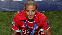 Bayern Munich's Thiago celebrates winning the Champions League with the trophy last month