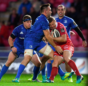 Leinster's Jack Conan tackles Hadleigh Parkes of Scarlets during the PRO14 match in Wales