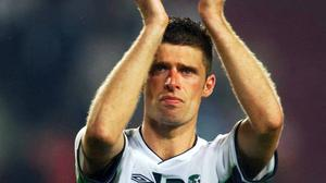 Niall Quinn bids farewell to the irish fans after the team's exit from World Cup 2002 and his international retirement