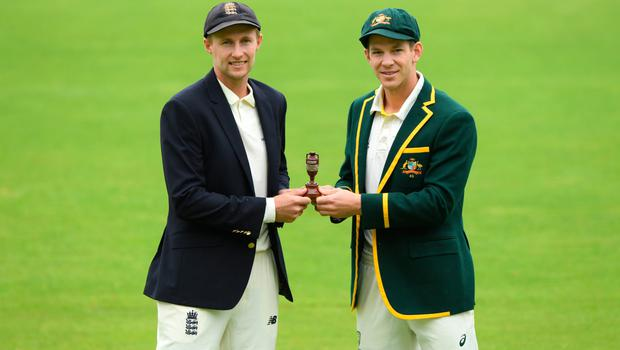England captain Joe Root (l) and Australia captain Tim Paine pictured holding the urn ahead of the First Ashes Test Match against Australia at Edgbaston in Birmingham