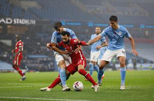 Liverpool's Mohamed Salah holds off Manchester City's Ruben Dias the at Etihad Stadium on Sunday