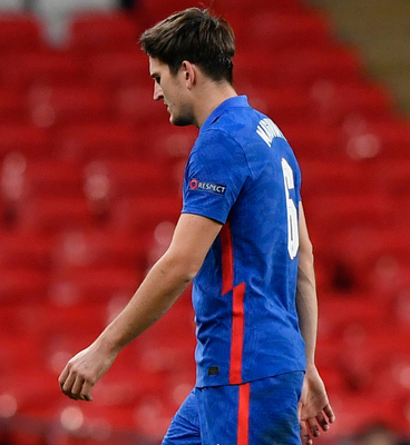 England's Harry Maguire walks off dejected after being sent off against Denmark