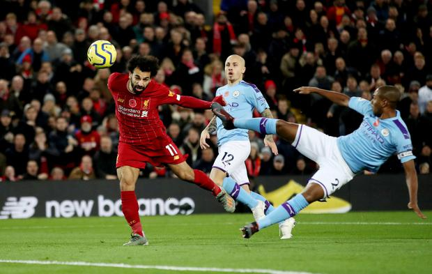 Liverpool's Mohamed Salah scores their second goal. Photo: Action Images via Reuters