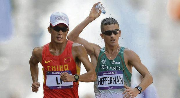 Ireland's Robert Heffernan, right, and Jianbo Li, China. Picture: Stephen McCarthy / SPORTSFILE