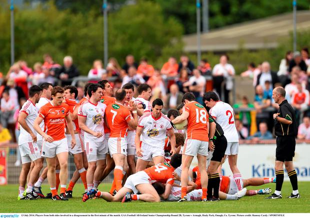 Players from both sides involved in a disagreement in the first minute of the match. GAA Football All-Ireland Senior Championship Round 2B, Tyrone v Armagh. Picture: Ramsey Cardy/SPORTSFILE