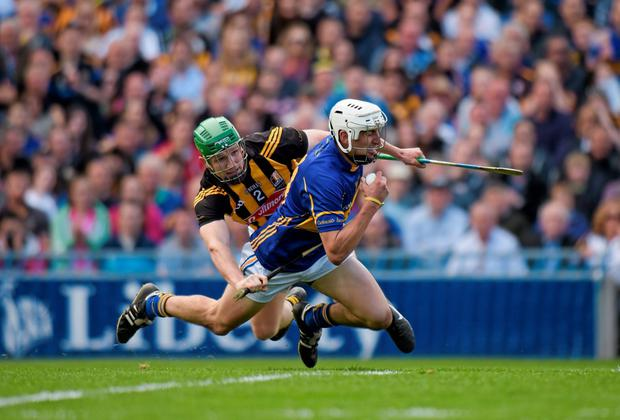 Patrick Maher, Tipperary, is taken down by Paul Murphy, Kilkenny