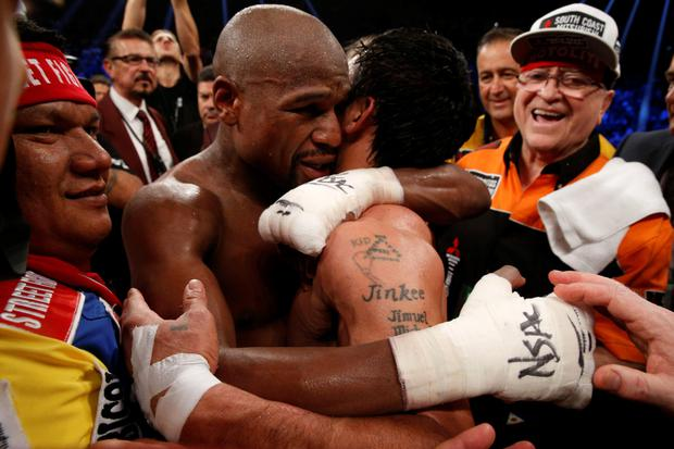 Floyd Mayweather Jr., hugs Manny Pacquiao after defeating Pacquiao in their welterweight unification bout on May 2, 2015 at the MGM Grand Garden Arena in Las Vegas, Nevada