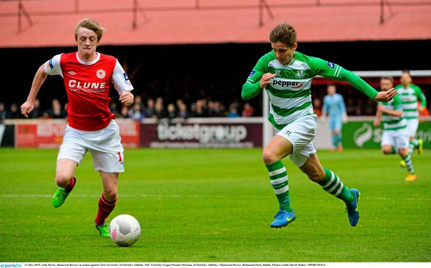 Luke Byrne, Shamrock Rovers, in action against Chris Forrester, St Patrick's Athletic. SSE Airtricity League Premier Division, St Patrick's Athletic v Shamrock Rovers. Richmond Park,