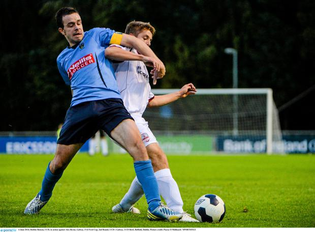 UCD striker Robbie Benson (left)