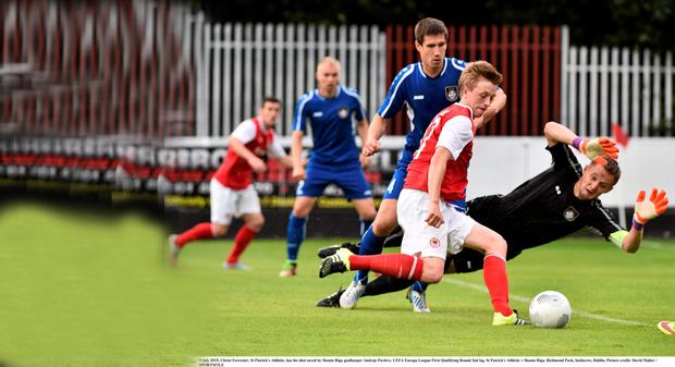 Christ Forrester, St Patrick's Athletic, has his shot saved by Skonto Riga goalkeeper Andrejs Pavlovs. UEFA Europa League First Qualifying Round 2nd leg, St Patrick's Athletic v Skonto Riga. Richmond Park