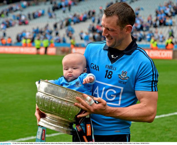 12 July 2015; Denis Bastik, Dublin, carries his 5-month-old son Aiden in the Delaney cup. Leinster GAA Football Senior Championship Final, Westmeath v Dublin, Croke Park, Dublin. Picture credit: Cody Glenn / SPORTSFILE