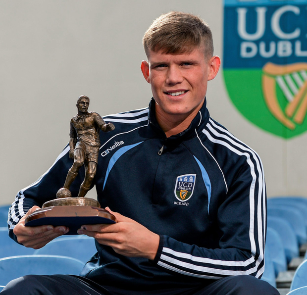 Ryan Swan of UCD with his SSE Airtricity player of the month award for July