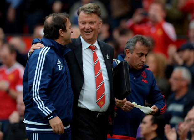 United boss Louis van Gaal talks to Sunderland's assistant manager Zeljko Petrovic after the game