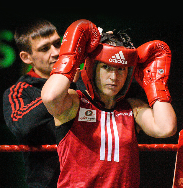 Katie Taylor (Bray Boxing Club) with her brother Lee, in her corner between rounds, during her 60kg bout in the IABA National Elite Female Championship Finals at the National Stadium in Dublin last night