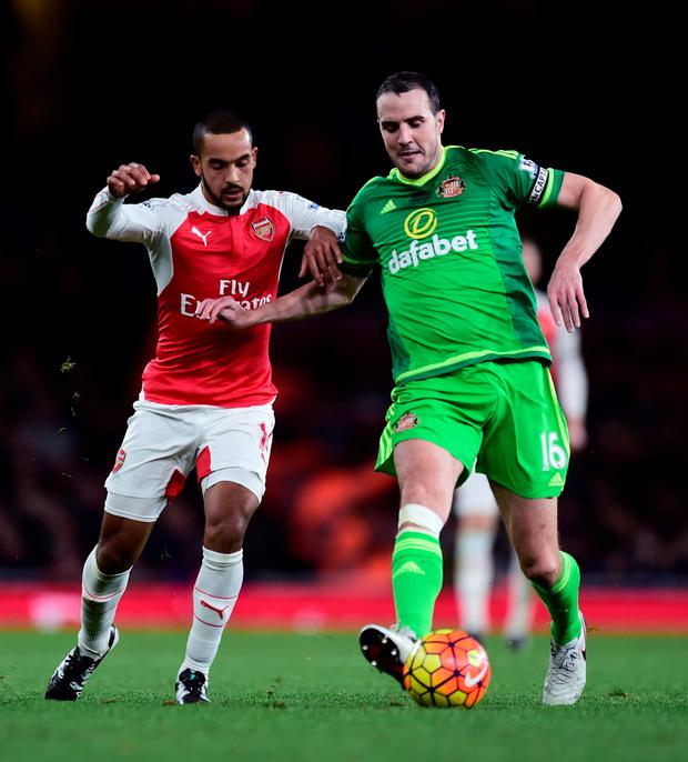 Ireland defender John O'Shea, in action (right) against Arsenal's Theo Walcott recently