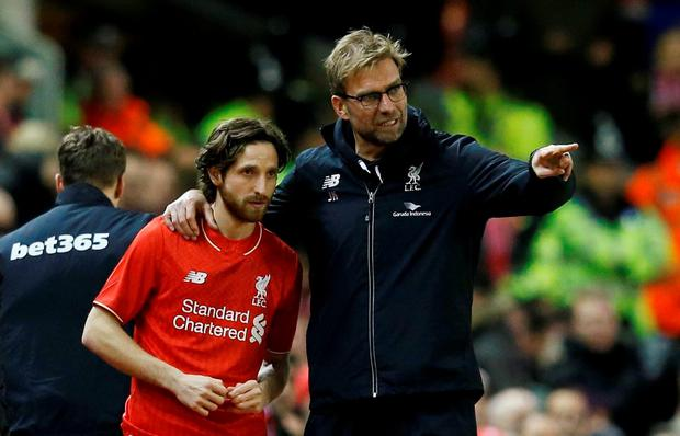 Joe Allen with Liverpool coach Jurgen Klopp Photo: Reuters