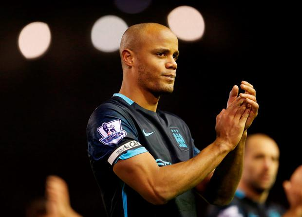 Manchester City's Vincent Kompany says his team is in a tough place Photo: Reuters