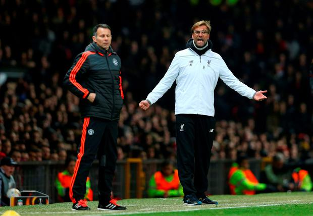 Man United Assistant Manager Ryan Giggs and Liverpool manager Jurgen Klopp. Pic: Clive Brunskill/Getty Images