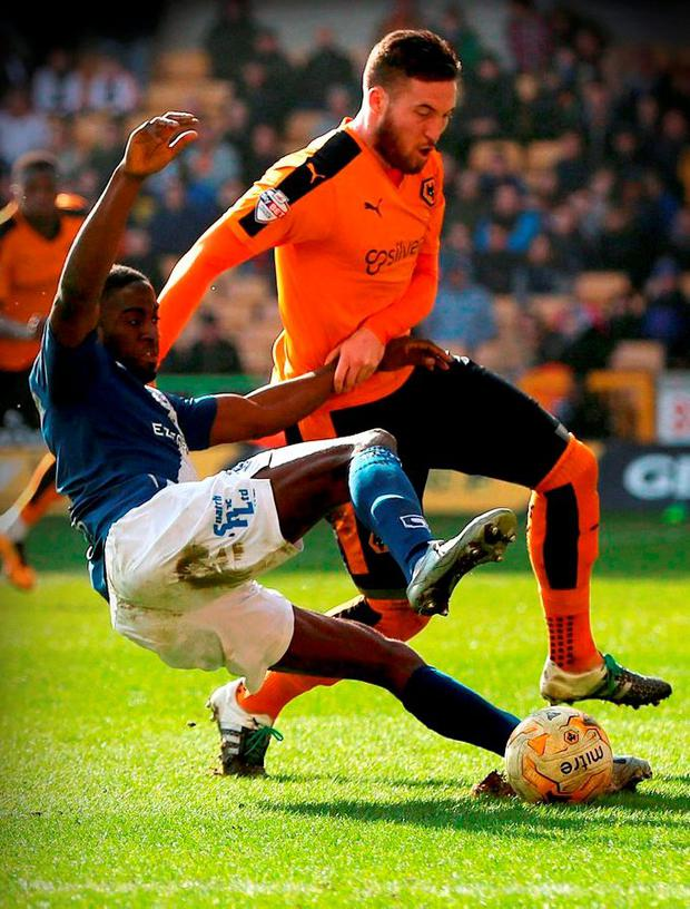 Birmingham's Clayton Donaldson is challenged by Wolves' Matt Doherty in the box during their Championship match at Molineux last weekend Photo: PA