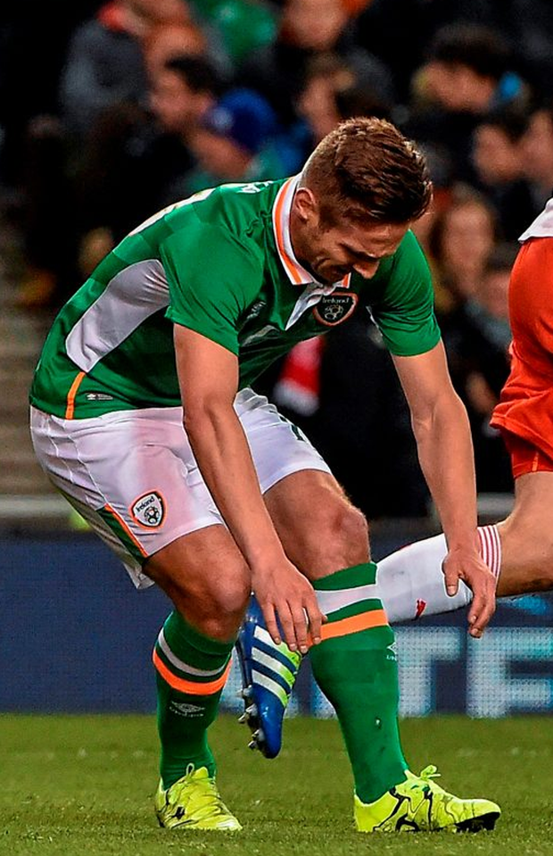 Kevin Doyle reacts after picking up an injury during the first half of the international against Switzerland at the Aviva Stadium. Pic: Sportsfile