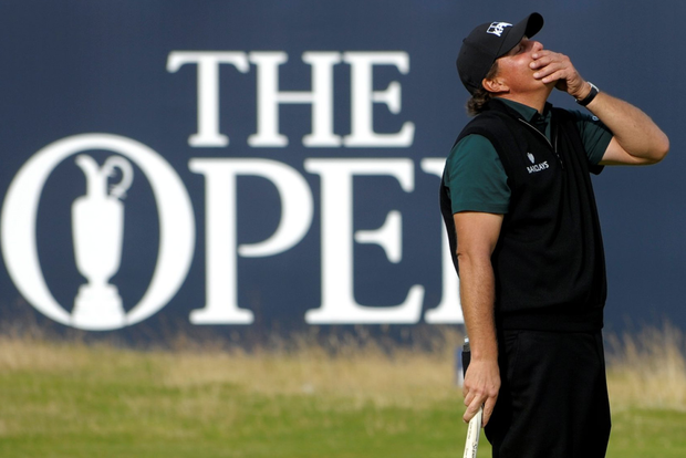 Phil Mickelson reacts after his birdie putt narrowly missed the hole on the 18th during the first round of the 145th Open Championship at Royal Troon. Photo: AFP/Getty Images