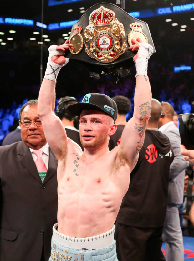 Carl Frampton holds up his championship belt after his WBA Super World Featherweight Championship win against Leo Santa Cruz at the Barclays Center in Brooklyn, New York on Saturday