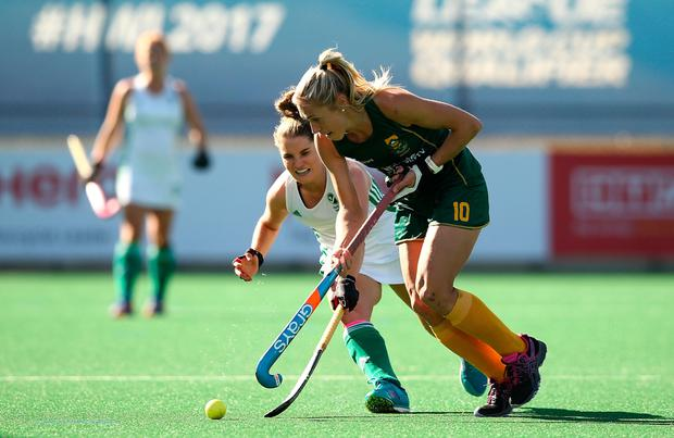 South Africa's Shelley Jones controls the ball from Ireland's Emily Beatty during the 5th/8th place play-off match at Wits University in Johannesburg yesterday. Pic: Sportsfile