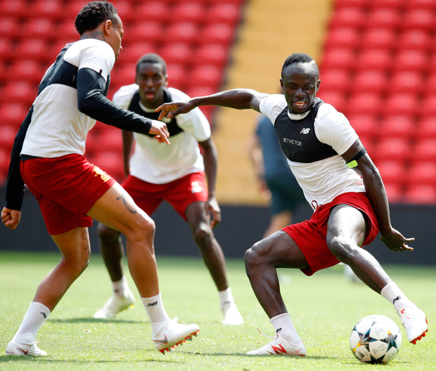 Kiev mission: Liverpool's Sadio Mane (right) and Nathaniel Clyne during a training session at Anfield yesterday