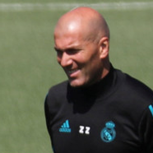 Watchful eye: Real Madrid manager Zinedine Zidane watches as Cristiano Ronaldo trains yesterday ahead of Saturday's Champions League final against Liverpool