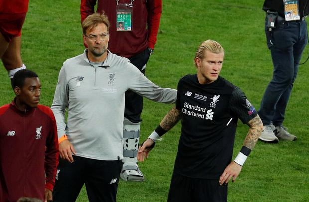 HEARTBROKEN: Liverpool boss Jurgen Klopp consoles Loris Karius after Saturday night's Champions League final in Kiev. Photo: REUTERS