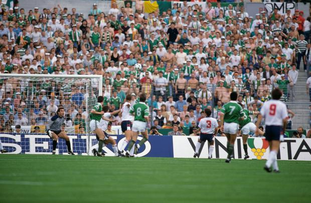 SPORTING HISTORY: Ireland's Ray Houghton (hidden right) heads past England goalkeeper Peter Shilton to score what proved to be the winning goal in the sixth minute of the Euro 88 group game in Stuttgart