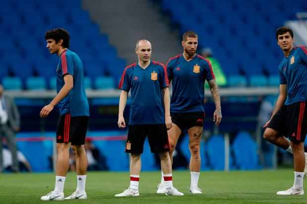 STAR MEN: (l-r) Spain's Andres Iniesta and Sergio Ramos are pictured in training at the Fisht Arena in Sochi ahead of this evening's Group B clash with Portugal. Pic: Getty Images