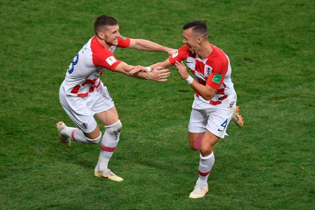 ON THE RADAR: Croatia's Ivan Perisic celebrates with Ante Rebic (L) after scoring during the World Cup final against France. Photo: AFP/Getty Images