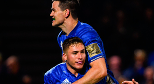 Jordan Larmour of Leinster celebrates with Jonathan Sexton (top) after scoring his side's third try during the Guinness PRO14 match against Edinburgh at the RDS