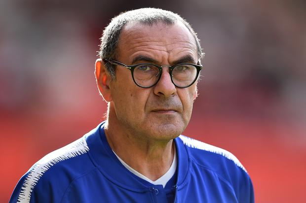 Manchester United manager Jose Mourinho faces off with Chelsea boss Maurizio Sarri (pictured) for the first time tomorrow